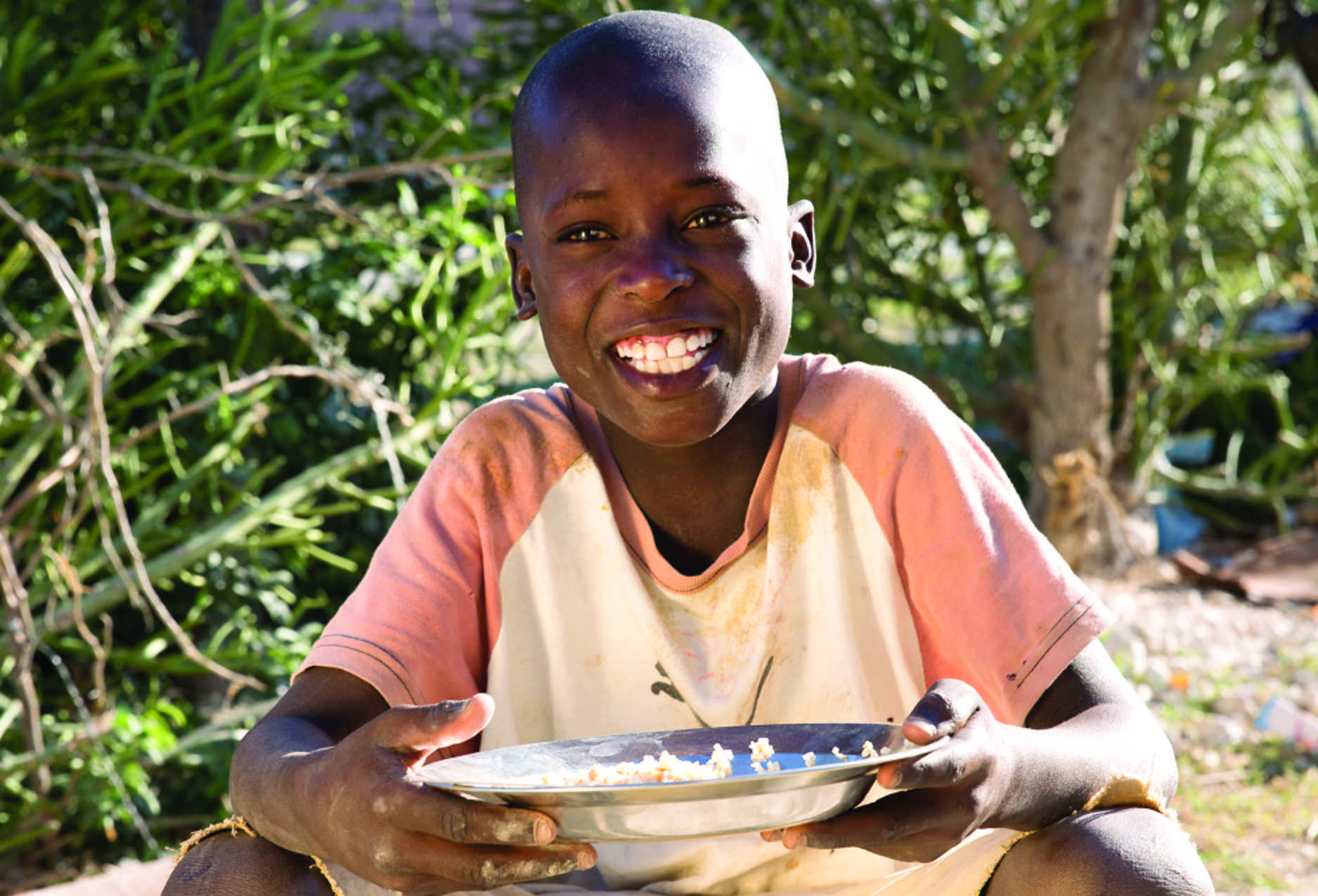 haitian-boy-with-food-provided-by-love-a-child