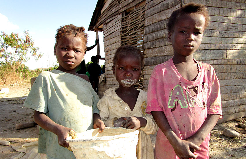 Starving children are living in filth and searching for food without hope.