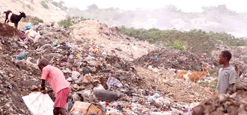 Children are living in the garbage dumps in the slums of Cité Soleil scrounging for food.