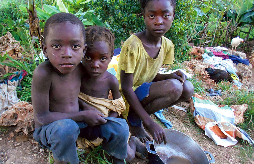 Poor Haitian children needing food and clothing.